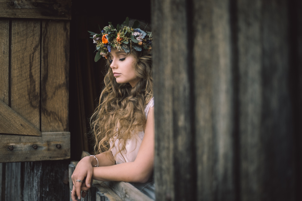 Girl with flower crown in alpine hut looking through a window - Snowy Mountains Weddings - Thredbo florist - Snowy Mountains Weddings - Thredbo Florists - Jindabyne Florists - Snowy Mountains Florists - Berridale Florist - Cooma Florists
